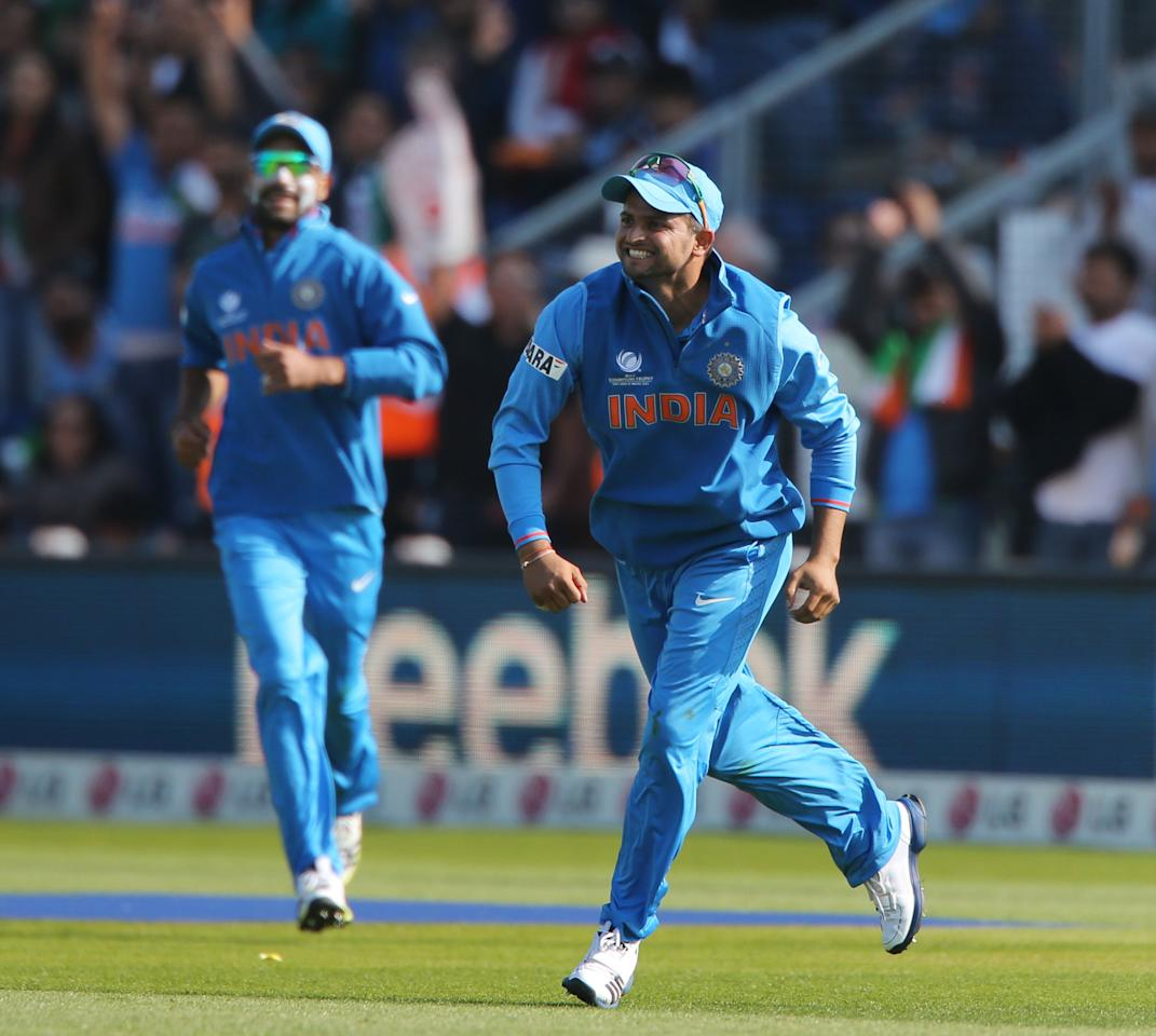 India's Suresh Raina celebrates catching South Africa batsman Faf Du Plessis opening day of the ICC Champions Trophy. The SWALEC Stadium, Cardiff.