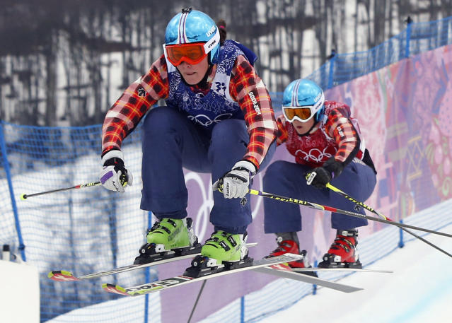 Canada's Marielle Thompson leads compatriot Kelsey Serwa in the women's ski cross final at the Rosa Khutor Extreme Park, at the 2014 Winter Olympics, Friday, Feb. 21, 2014, in Krasnaya Polyana, Russia. (AP Photo/Sergei Grits)