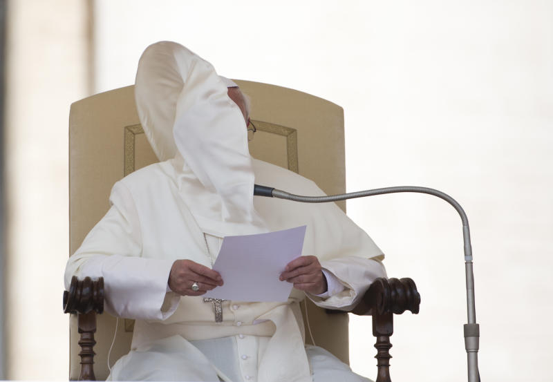 A gust of wind blows Pope Francis' mantle as he reads his speech in St. Peter's square at the Vatican after his weekly general audience Wednesday, June 26, 2013. (AP Photo/Alessandra Tarantino)