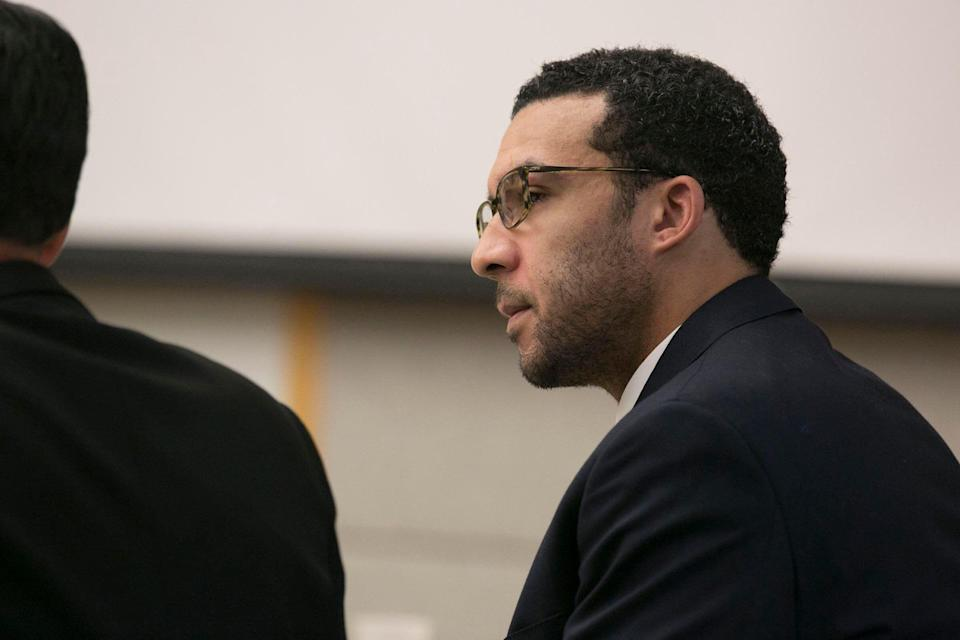Former NFL football player Kellen Winslow Jr. looks at attorney Marc Carlos during his rape trial. (AP)