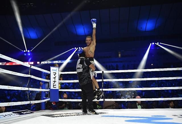 Rosales celebrates his win over Higa (AFP Photo/Kazuhiro NOGI)