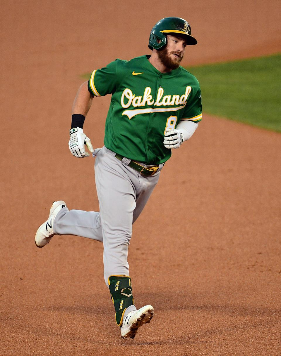 Oakland Athletics left fielder Robbie Grossman rounds the bases after hitting a solo home run against the Los Angeles Dodgers at Dodger Stadium, Sept. 22, 2020.