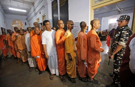 Hindu holy men stand in a queue inside a polling station to caste their vote during the final phase of general election in Kolkata, India, May 19, 2019. REUTERS/Rupak De Chowdhuri