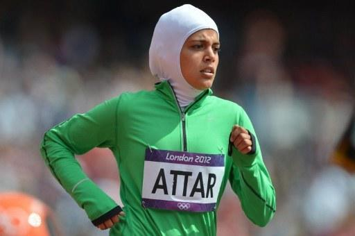 Saudi Arabia's Sarah Attar competes in the women's 800m heats at the athletics event of the London 2012 Olympic Games on August 8, 2012 in London. AFP PHOTO / JOHANNES EISELE