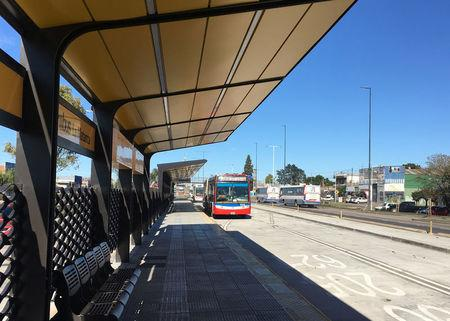 A bus arrives at a soon-to-be completed bus lane in the working-class district of La Matanza