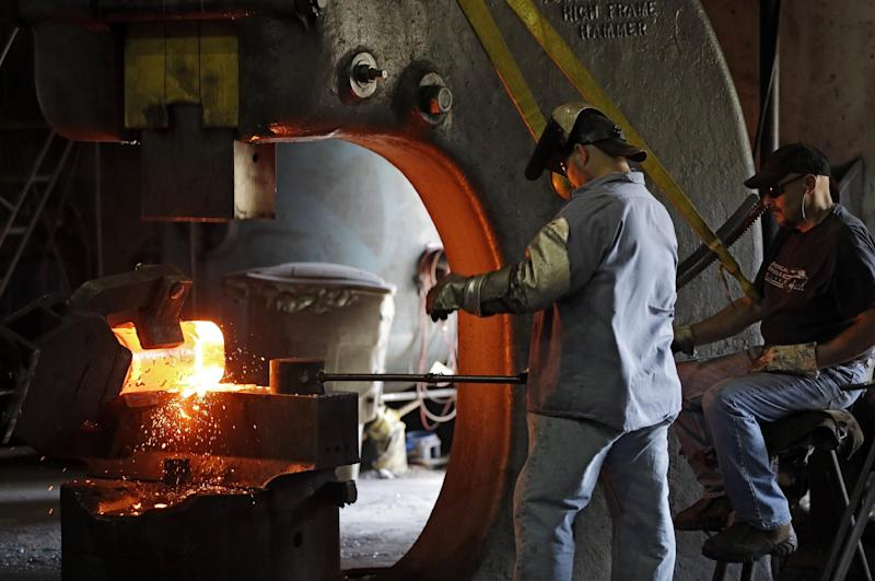 In this Thursday, Sept. 6, 2012 photo, workers form a large spindle from glowing hot metal at Solmet Technologies in Canton, Ohio. The steel forging company produces tool parts and oil and gas drilling components. Ohio was once synonymous with steel and rubber, but the era when Goodyear, Firestone and LTV dominated the Ohio landscape is long gone; the state has lost more than 368,000 manufacturing jobs since 2000. But heavy industry still has an enormous presence. In this crucial battleground in campaign 2012, the best way to jump-start the nation's stalled economy reveals a deep divide. (AP Photo/Mark Duncan)