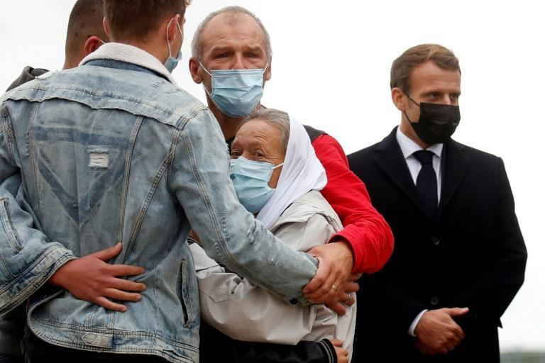 Hostage release: French President Emmanuel Macron, right, stands next to French aid worker Sophie Petronin, centre, as she is welcomed by her family on her return to France