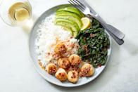 """Sweet scallops meet their perfect partners in luscious avocado and a spicy, crunchy, garlicky oil. <a href=""""https://www.epicurious.com/recipes/food/views/scallop-rice-bowls-with-crunchy-spice-oil?mbid=synd_yahoo_rss"""" rel=""""nofollow noopener"""" target=""""_blank"""" data-ylk=""""slk:See recipe."""" class=""""link rapid-noclick-resp"""">See recipe.</a>"""