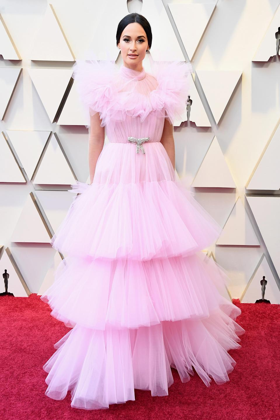 """<p>The """"Space Cowboy"""" singer and Oscar presenter turned heads in a ruffled pink gown by Giambattista Valli. (Image via Getty Images) </p>"""
