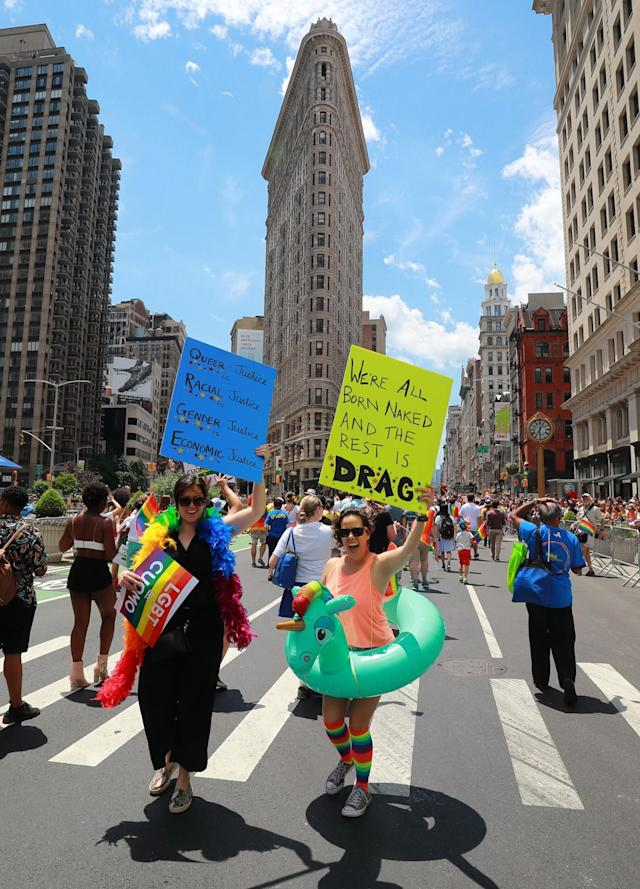 <p>Marchers hold up signs during the N.Y.C. Pride Parade in New York on June 25, 2017. (Photo: Gordon Donovan/Yahoo News) </p>