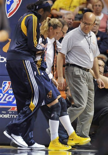 Indiana Fever's Katie Douglas is helped off the court after injuring her ankle during the first half of Game 3 of the WNBA basketball Eastern Conference finals against the Connecticut Sun in Uncasville, Conn., Thursday, Oct. 11, 2012. (AP Photo/Jessica Hill)