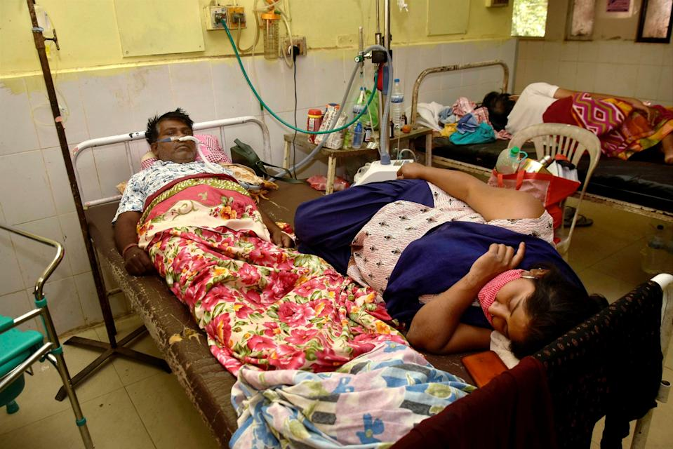 Ranchi: COVID-19 patients on Friday, 16 April, share a common bed at the casualty ward of Rajendra Institute of Medical Sciences (RIMS) hospital in Ranchi as shortage of bed increased due to rising cases.