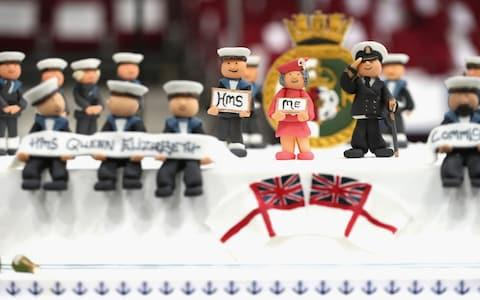 Commissioning cake featuring a figurine of the Queen - Credit: AFP/Chris Jackson