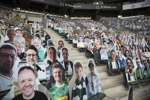Bundesliga club Borussia Mönchengladbach placed pictures of fans in seats before Saturday's match against Bayern Leverkusen. (Christian Verheyen/Getty Images)
