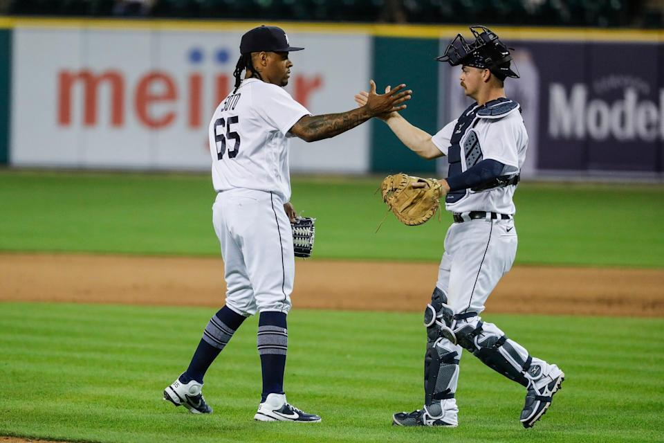 Detroit Tigers pitcher Gregory Soto (65) celebrates with catcher Jake Rogers (34) after the Tigers' 1-0 win over Cleveland at Comerica Park in Detroit on Wednesday, May 26, 2021.