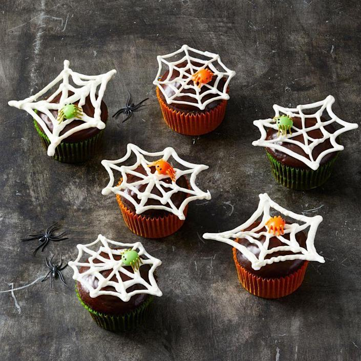 """<p>These creepy crawly cupcakes will stand out on the desserts table.</p><p>Get the recipe from <a href=""""https://www.goodhousekeeping.com/holidays/halloween-ideas/g2711/halloween-cupcakes/?slide=1"""" rel=""""nofollow noopener"""" target=""""_blank"""" data-ylk=""""slk:Good Housekeeping"""" class=""""link rapid-noclick-resp"""">Good Housekeeping</a>.</p>"""