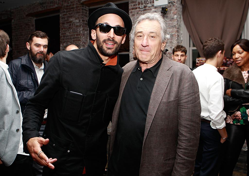 "NEW YORK - APRIL 20:  Artist JR and Co-Founder of the Tribeca Film Festival Robert DeNiro attends the afterparty for  HBO's Inside Out: ""The People's Art Project"" premiere at Tribeca Film Festival on April 20, 2013 in New York City.  (Photo by Mark Von Holden/Getty Images for HBO)"