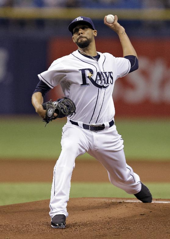 Tampa Bay Rays starting pitcher David Price delivers to Baltimore Orioles' Manny Machado during the first inning of a baseball game Thursday, May 8, 2014, in St. Petersburg, Fla. (AP Photo/Chris O'Meara)