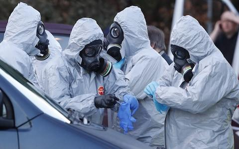 Emergency workers wear protective equipment in Salisbury at one of the scenes of investigation of the nerve agent attack - Credit: Peter Macdiarmid/LNP