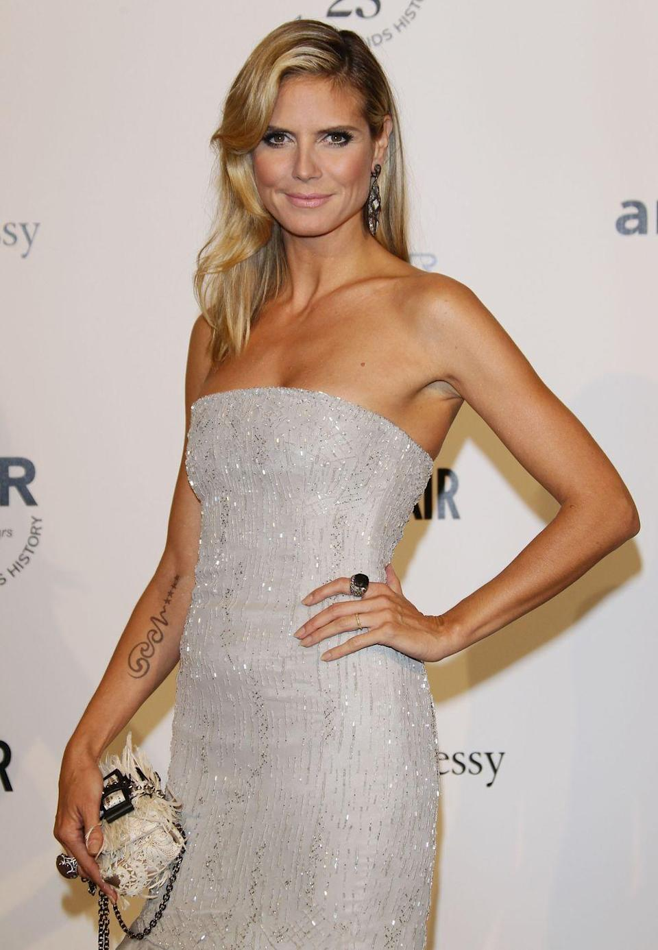 """<p>After splitting from husband of nine years Seal, Heidi Klum finalized the end of their marriage by removing the tattoo of his name from her right inner arm. The TV host and """"Kiss From a Rose"""" singer commemorated their fourth wedding anniversary with a vow renewal ceremony and tats of each other's names. A decision that later, for Heidi, did not make the cut.</p>"""