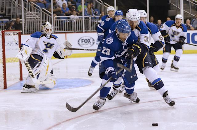 Tampa Bay Lightning right wing J.T. Brown (23) gets position in front of St. Louis Blues center Alex Bolduc (37) during the second period of an NHL preseason hockey game in Orlando, Fla., Wednesday, Sept. 18, 2013.(AP Photo/John Raoux)