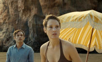 """This image released by Universal Pictures shows Gael García Bernal and Vicky Krieps in a scene from """"Old."""" (Universal Pictures via AP)"""