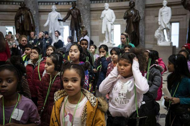 PHOTO: A group of schoolchildren walk through Statuary Hall while on a tour of the U.S. Capitol as debate on the articles of impeachment against President Trump continues on the House floor on Dec. 18, 2019, in Washington. (Drew Angerer/Getty Images)