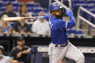 Toronto Blue Jays' Teoscar Hernandez hits a double during the first inning of a baseball game against the Miami Marlins, Wednesday, June 23, 2021, in Miami. The hit allowed the first run of the game. (AP Photo/Marta Lavandier)