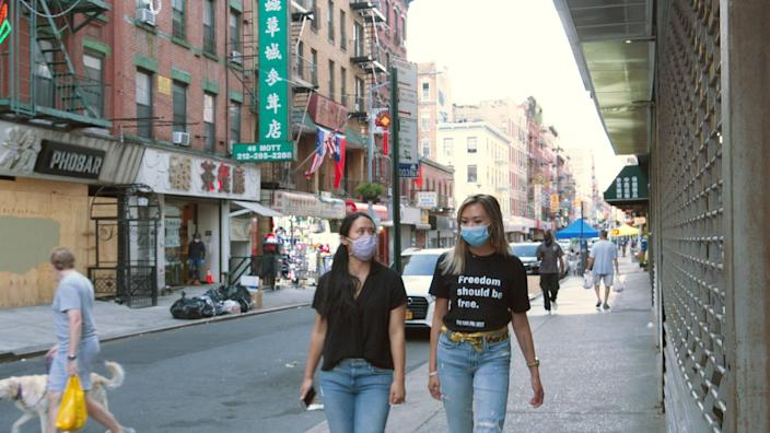 Jennifer Tam (L) and Victoria Lee started the grassroots organization Welcome to Chinatown in March to support local businesses.