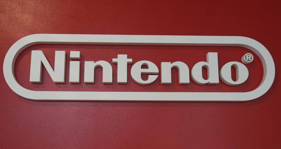 In this June 19, 2018, photo, a logo of Nintendo hangs at Panasonic center in Tokyo. Nintendo, the Japanese video game maker behind the Super Mario and Pokemon franchises, is reporting a 25 percent jump in fiscal third-quarter profit, boosted by the popularity of games for its Switch console. (AP Photo/Koji Sasahara)
