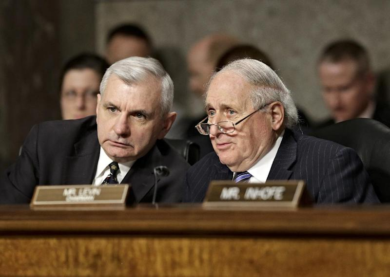 FILE - In this Jan. 31, 2013 file photo, Senate Armed Services Committee Chairman Sen. Carl Levin, D-Mich., right, talks with committee member Sen. Jack Reed, D-R.I., during the the committee's confirmation hearing for former Nebraska Republican Sen. Chuck Hagel, President Obama's choice for defense secretary, on Capitol Hill in Washington. Levin said Friday he will press ahead with a vote on Hagel's nomination to be defense secretary, rejecting Republicans demands for more financial information from President Barack Obama's choice as setting an unprecedented new standard. (AP Photo/J. Scott Applewhite, File)