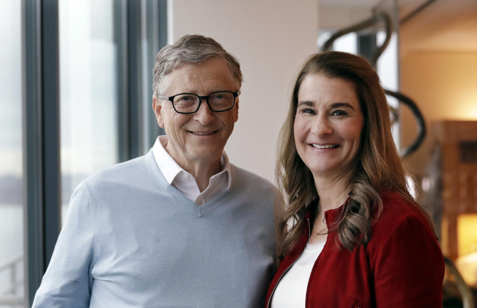 """In this photo taken Feb. 1, 2019, Bill and Melinda Gates pose for a photo in Kirkland, Wash. From their perch as the """"unofficial deans"""" of big-ticket philanthropy, it's business as usual for the Gates amid questions about whether altruism by the wealthy is a force for good. They are speaking out as their annual letter reviewing their work and vision is released. This year's note focused on 2018's surprises in the areas where the Bill and Melinda Gates Foundation are involved, including global health and development and U.S. education and poverty. (AP Photo/Elaine Thompson)"""
