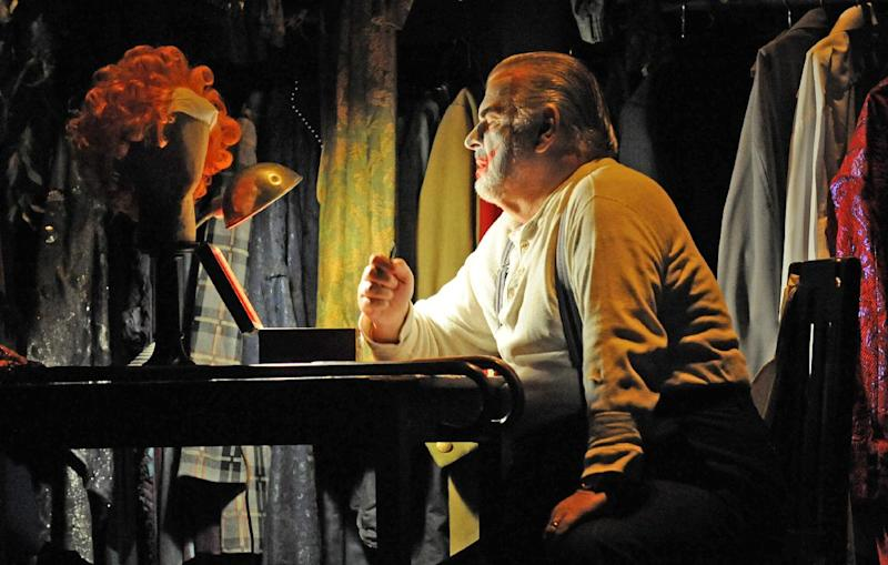 "This Sept. 15, 2010 photo released by Opera Australia shows Alan Opie in the title role of Opera Australia's ""Rigoletto,"" in Sydney. The first of Giuseppe Verdi's three great middle period triumphs has been shifted before to New York's Little Italy, Federico Fellini's Rome, modern-day Hollywood and even the Oval Office. Now it will take place amid dazzling Sin City lights and not in the Renaissance Palazzo Ducale when Michael Mayer's version of the 162-year-old classic opens Monday night. (AP Photo/Opera Australia, Branco Gaica)"