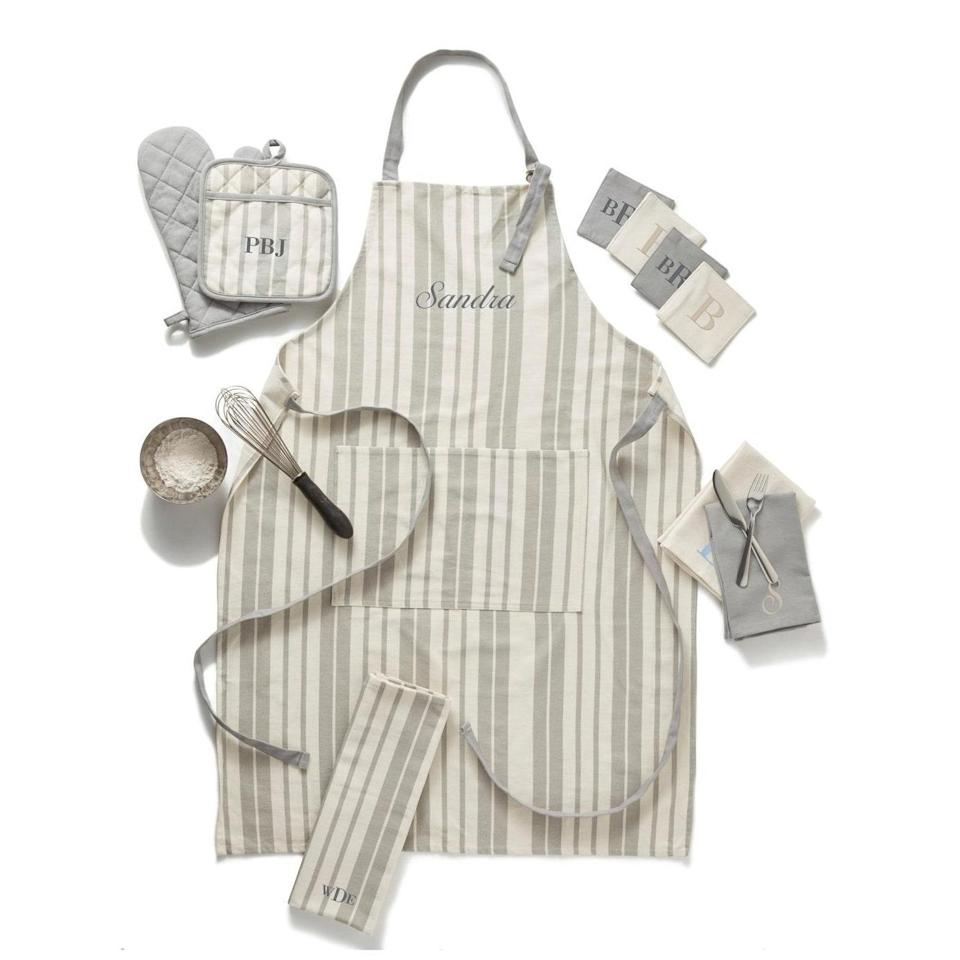 """A customizable linen set is the perfect way to liven up her kitchen space, and the subtle stripes won't clash with any seasonal decor. $45, Etsy. <a href=""""https://www.etsy.com/listing/721783203/personalized-apron-with-pocket?"""" rel=""""nofollow noopener"""" target=""""_blank"""" data-ylk=""""slk:Get it now!"""" class=""""link rapid-noclick-resp"""">Get it now!</a>"""