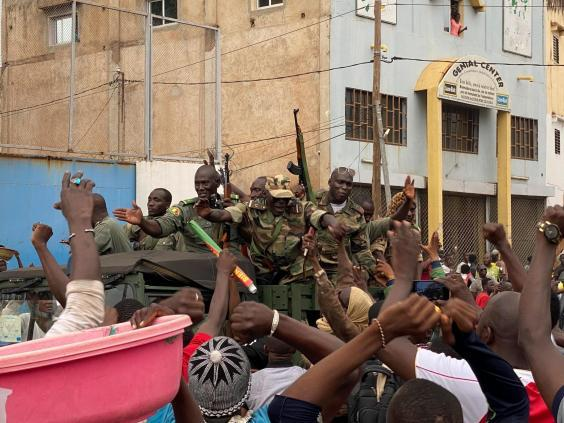 Malian soldiers are celebrated as they arrive at the Independence square in Bamako (AFP/Getty)