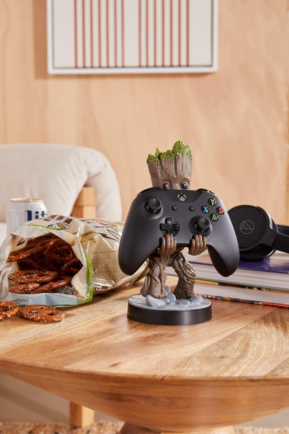 <p>If he's the ultimate gamer, then get him this fun yet useful <span>Cable Guys Toddler Groot Device Holder</span> ($25). Toddler Groot can hold his gaming consoles, smartphone, headphones, and more. </p>