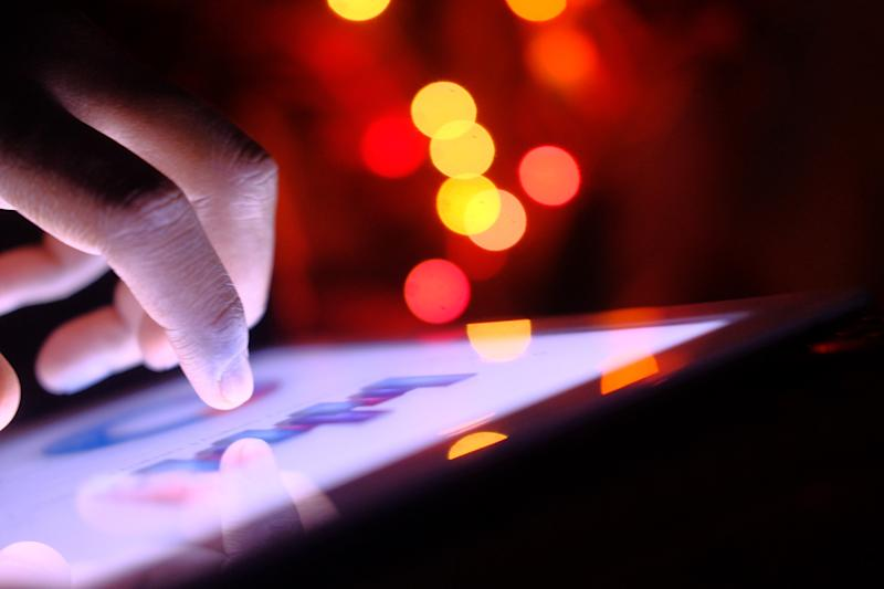 cropped man hand analyzing stock market data on digital tablet