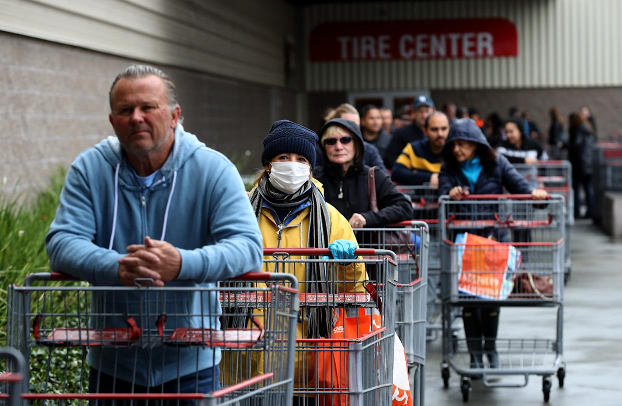 NOVATO, CALIFORNIA - MARCH 14: Hundreds of customers wait in line to enter a Costco store on March 14, 2020 in Novato, California. Some Americans are stocking up on food, toilet paper, water and other items after the World Health Organization (WHO) declared Coronavirus (COVID-19) a pandemic. (Photo by Justin Sullivan/Getty Images)
