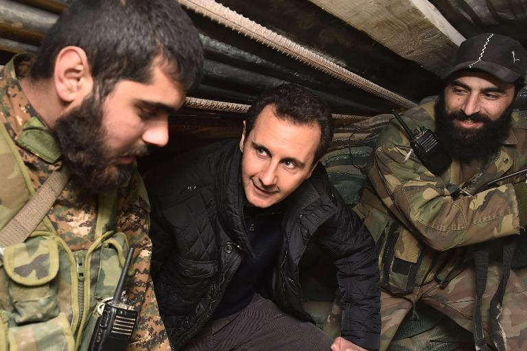A picture released by the Syrian Arab News Agency shows Syrian President Bashar al-Assad (C) talking with troops during a reported visit to the eastern Damascus district of Jobar on December 31, 2014
