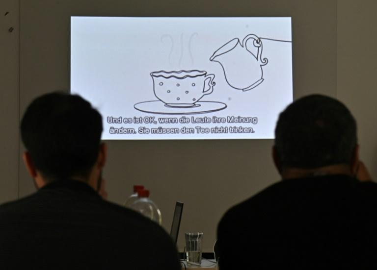 One of the short videos during the refugee workshop in Berlin uses the idea of asking someone if they want tea to help spell out the difference between consensual sex and rape (AFP Photo/Tobias SCHWARZ)