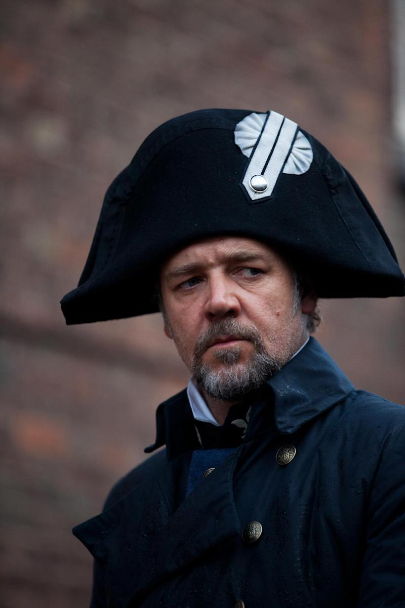 "This undated publicity image provided by Universal Pictures shows Russell Crowe as Javert, center, in a scene from the motion-picture adaptation of ""Les Misérables,"" directed by Tom Hooper. A familiar lineup of Hollywood awards contenders are expected among Golden Globe nominations coming out Thursday morning, Dec. 13, 2012, whose prospects include past Oscar winners Daniel Day-Lewis, Helen Mirren, Robert De Niro and Sally Field. Other Oscar recipients may be nominated, such as Mirren and Anthony Hopkins for ""Hitchcock,"" Philip Seymour Hoffman for ""The Master,"" Helen Hunt for ""The Sessions,"" Marion Cotillard for ""Rust and Bone,"" Russell Crowe for ""Les Miserables"" and Alan Arkin for ""Argo."" (AP Photo/Universal Pictures, Laurie Sparham)"