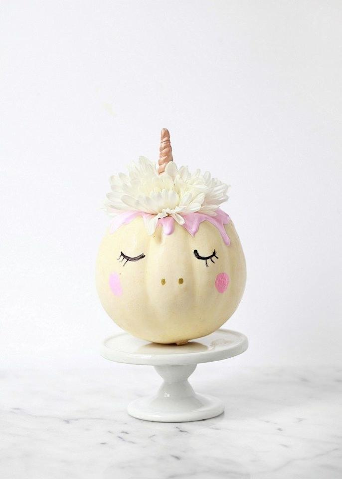 "<p>This little unicorn is a far cry from your traditional jack-o-lantern, but it couldn't be cuter. There's hardly any carving required at all—simply carve out the top and two little holes for the nose. Then, use a little craft paint and some flowers to bring the mystical creature to life.  </p><p><a class=""body-btn-link"" href=""https://www.amazon.com/DecoArt-Crafters-Acrylic-2-Ounce-Blossom/dp/B000XZVPAG/?tag=syn-yahoo-20&ascsubtag=%5Bartid%7C10072.g.28337071%5Bsrc%7Cyahoo-us"" target=""_blank"">SHOP PAINT</a></p><p><a class=""body-btn-link"" href=""http://poshlittledesigns.com/2016/10/28/mini-pumpkin-unicorns/"" target=""_blank"">GET THE TUTORIAL</a></p>"