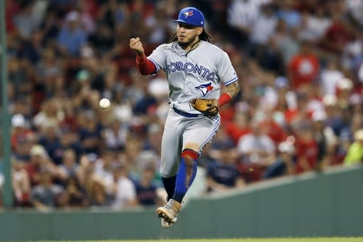 Toronto Blue Jays' Freddy Galvis bobbles the ball on the infield single by Boston Red Sox's Mookie Betts during the seventh inning of a baseball game in Boston, Tuesday, July 16, 2019. (AP Photo/Michael Dwyer)