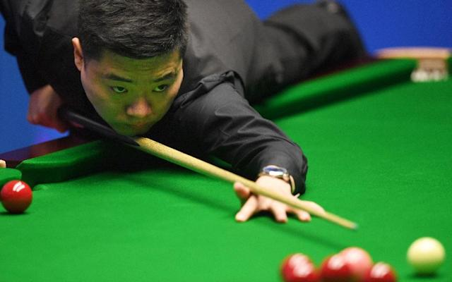 China's Ding Junhui plays a shot against China's Zhou Yuelong during their first round game of the World Snooker Championships in Sheffield, northern England, on April 18, 2017 (AFP Photo/Paul ELLIS)