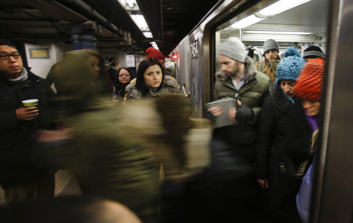 In this Tuesday, Feb. 5, 2013 photo, rush hour commuters wait as others leave a subway along the Lexington Avenue line in New York. The construction of the Second Avenue Subway on Manhattan's far East Side will open travel for millions and ease congestion. (AP Photo/Bebeto Matthews)