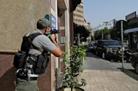 A fighter of the Shiite Amal movement takes aim during clashes in Tayouneh in Beirut's southern suburbs (AFP/ANWAR AMRO)