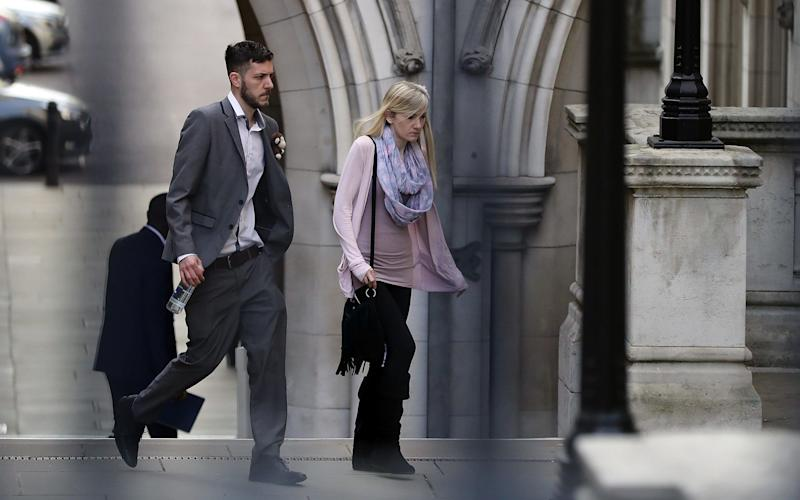 Charlie Gard's parents walk through the grounds of the Royal Courts of Justice - Credit:  Dan Kitwood/Getty Images
