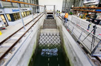 This photo taken in Jan. 2019 and made available by Deltares shows the flume wave tank in Delft, Netherlands, that is used to test structure designs for the strengthening work for the Afsluitdijk. With climate change bringing bigger storms and rising sea levels, one of the low-lying Netherlands' key defenses against the sea is getting a major makeover. The 5-year project will see workers lay thousands of concrete blocks and raise parts of the 87-year-old Afsluititdijk dike. (Guus Schoonewille/Deltares via AP)