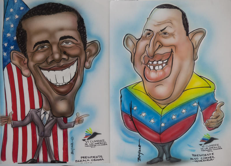 Cartoon drawings of President Barack Obama, left, and Venezuela's President Hugo Chavez, by caricature artist Martin Bayona are on display at the Summit of the Americas media center in Cartagena, Colombia, Thursday April 12, 2012. Western Hemisphere leaders will gather this weekend for the sixth Summit of the Americas. Colombian President Juan Manuel Santos said Chavez, who is undergoing cancer treatment, would attend this weekend's summit only if his doctors give him the green light to travel to Colombia's coastal city of Cartagena. (AP Photo/Fernando Vergara)