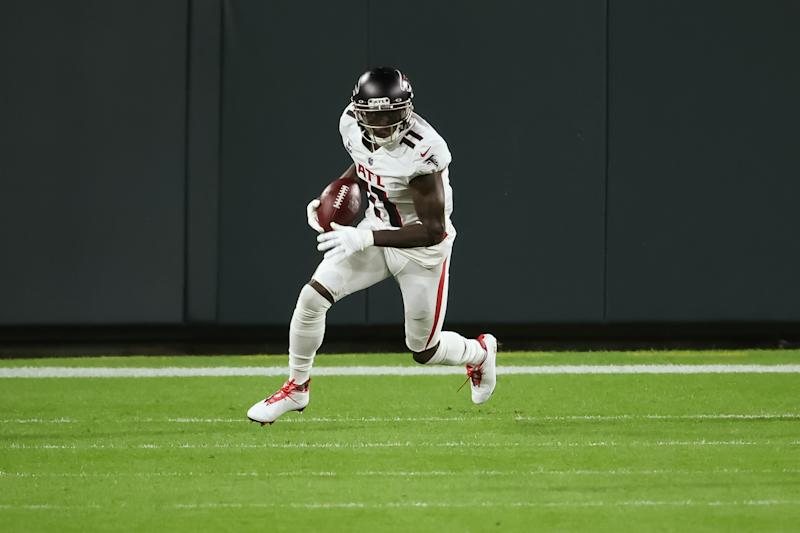 GREEN BAY, WISCONSIN - OCTOBER 05: Julio Jones #11 of the Atlanta Falcons runs with the ball in the first quarter against the Green Bay Packers at Lambeau Field on October 05, 2020 in Green Bay, Wisconsin. (Photo by Dylan Buell/Getty Images)